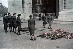 War to end all wars? Women in military uniforms look at a war memorial commemorating those killed in the First World War just over two decad...