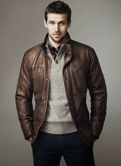 Shop this look for $131:  http://lookastic.com/men/looks/brown-bomber-jacket-and-grey-henley-sweater-and-navy-chinos-and-white-and-red-and-navy-longsleeve-shirt/1377  — Brown Leather Bomber Jacket  — Grey Henley Sweater  — Navy Chinos  — White and Red and Navy Plaid Longsleeve Shirt
