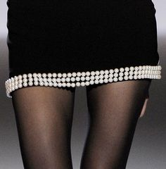 the pearls give the dress a precious look.