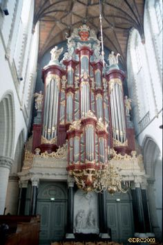 This beautiful baroque era (1738) organ appears to be at the St. Bavokerk in Haarlem, Holland and reportedly was played by Mozart.