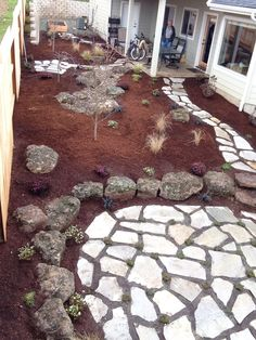 Flagstone paths and patios, boulders as a small retaining wall