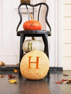 Monogrammed pumpkins  Create a welcoming fall scene with personalized pumpkins. Etch your monogram into small, medium and large pumpkins, using different fonts and styles. (You can get a similar look with paint if you'd prefer not to etch.) Show off your pumpkins on an old chair or stool.
