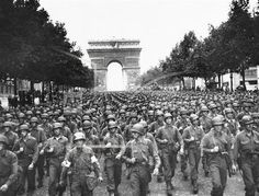 WWII France, Liberation of Paris U.S. soldiers of Pennsylvania's 28th Infantry Division march along the Champs Elysees, the Arc de Triomphe in the background, on Aug. 29, 1944, four days after the liberation of Paris, France.