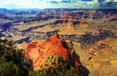 The Grand Canyon is located in northern Arizona and is one of the great tourist attractions in the United States. Carved over several million years by the Colorado River, the canyon attains a depth of over 1.6 km (1 mile) and 446 km (277 miles) long. The Grand Canyon is not the deepest or the longest canyon in the world but the overwhelming size and its intricate and colorful landscape offers visitor spectacular vistas that are unmatched throughout the world.