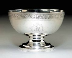 A SILVER PUNCH BOWL  Maker's mark of Paul Revere, Jr., Boston, circa 1795  Circular on a conforming foot with bright-cut border, the body with bright-cut band of running acorns and leaves on a reeded ground, one side engraved with script monogram SS within a key pattern circle, marked under base with Kane mark C or D  6½in. diameter; 13oz. 10dwt.
