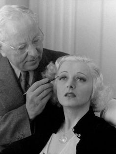 Renowned Hollywood Makeup Expert Max Factor Drawing Eyebrows on Blond Model