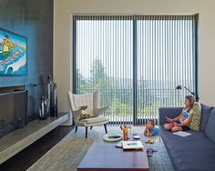 Take total control with PowerView™ motorized Luminette® Privacy Sheers to automatically control unwanted light glare from doors and large window expanses. ♦ Hunter Douglas window treatments  #LivingRoom