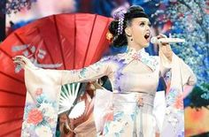 """Katy Perry took American Music Awards viewers on a trip to Japan during a sophisticated and oft-high flying opening performance of new single """"Unconditionally"""" on Sunday. American Music Awards, Katy Perry Unconditionally, Katy Perry Live, Kimono Vintage, Big Kiss, Cultural Appropriation, Cultural Identity, Stevie Wonder, Lingerie"""