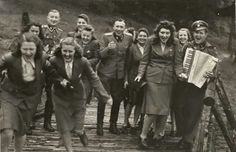 SS-Officers and Helferinnen at Solahütte, close by the Konzentrationslager Auschwitz. It had just started raining and the girls were running for cover.