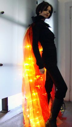 "This girl crafted her own ""girl on fire cape"" - still trying to convince Jesse to be my Peeta for Halloween"