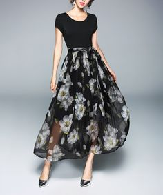 Take a look at this Black Floral Fit & Flare Dress today!