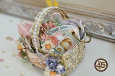 This perfectly precious Easter basket and Egg mini album is by Maiko using Sweet Sentiments! The basket is made of Graphic 45 Washi Tape, and Maiko even has a Snapguide tutorial! #graphic45 #tutorials #easter