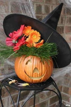 Such a cute pumpkin carving idea with the bouquet and witch hat