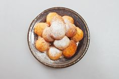 Cottage cheese donuts in powdered sugar. Recipe: http://wonderdump.com/cottage-cheese-donuts-in-powdered-sugar/