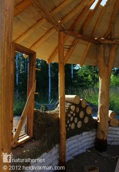 Earthbag and cordwood walls in the roundwood frame