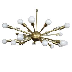 BRASS SPUTNIK CHANDELIER WITH TWENTY FOUR ARMS | From a unique collection of antique and modern chandeliers and pendants  at https://www.1stdibs.com/furniture/lighting/chandeliers-pendant-lights/