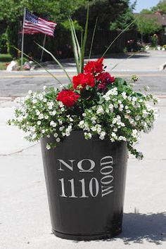 An old metal school trash can turned into an address planter!  Love it!  The Project Spot: Garbage Can Planter