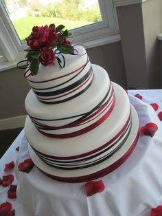 White red and black ribbon wedding cake with sugar roses