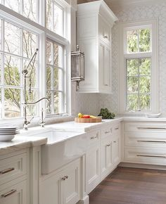 The details in this kitchen...wall sconce and commercial spray with an elegant touch and finishes....❤️ ncs