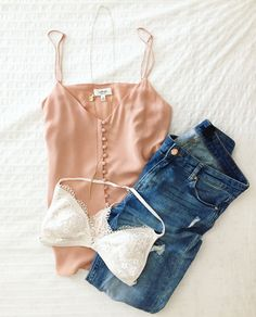 Go for a sultry, effortless look with just a peek of your bra and distressed jeans.