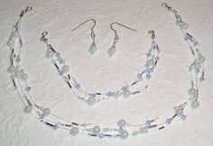 Sterling Silver Swarovski Crystal Illusion Set.  Necklace, Bracelet and Earrings.  Purple. on Etsy, £25.00