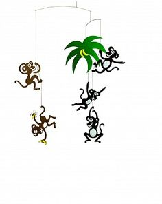 Monkey tree mobile by Flensted. This playful monkeys hang down a palm tree. The mobile is full of life and fun - just a good thing for little kids.