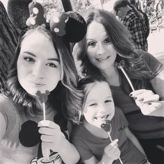 Just us #Girls with our #mickeymouse lollipops waiting for the boys to get back. Love my momma and little sis #muah #california #LA #Disneyland #californiaadventure by coley_1837
