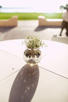 To have a truly beautiful wedding, don't over do it. We love the #charm, #elegance + #sophistication of this #simple, #babiesbreath #bouquet + #darling #little #vase. ::Nicole + Jesse's bayfront summer wedding in Sarasota, Florida:: #weddingreception #diy #decorideas #beautiful #weddingphotography #details