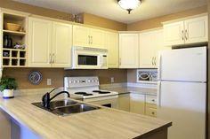 Condo in Edmonton $158700.00  #104 17404 64 Avenue Condo, Kitchen Cabinets, Home Decor, Decoration Home, Room Decor, Kitchen Cupboards, Interior Design, Home Interiors, Kitchen Shelves