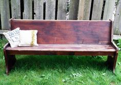 vintage bench with burlap pillows