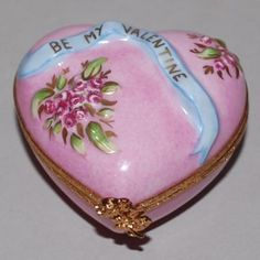 Ltd Edition Limoges ARTORIA Hand Painted Porcelain VALENTINE Heart Trinket Box Ref: BE021111 Pretty hand painted porcelain trinket box in the form a pink heart with embossed flowers and a blue ribbon
