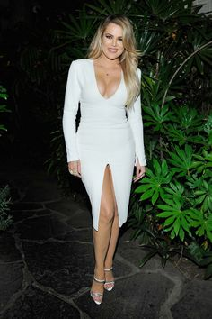 Va-Va Voom from Khloe Kardashian's Best Looks The E! star is smokin' hot in a plunging white dress with a center slit at Opening Ceremony and Calvin Klein's Denim Series launch event in Los Angeles. Kardashian Dresses, Khloe Kardashian Photos, Estilo Kardashian, Kardashian Family, Kardashian Jenner, Kendall Jenner, Kylie, Men's Fashion, Fashion Week