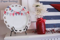 4th of July Mantel decorations.  Love the mini paper bunting across the white plate.
