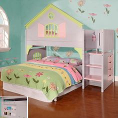 Discovery Dollhouse Staircase Bed with Twin Bed on top and underneath bed play area that can accommodate a twin, full or queen bed (not included).