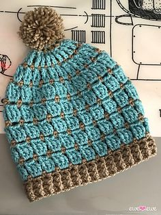 Projects For Kids The Wooly Windows crochet beanie uses two colors of Wooly Worsted yarn to work a playful cluster stitch with little hints of color in between. Choose the size you need from baby to kids to adult. You'll love to work this hat a few times! Bonnet Crochet, Crochet Beanie Pattern, Crochet Cap, Crochet Stitches, Free Crochet, Crochet Dolls, Doll Patterns, Free Knitting, Crochet Hat Patterns