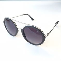 Black and silver sunglasses UV400 Protection sunglasses! Does not come with a case. About 5 3/4 inches wide April Spirit Accessories Sunglasses