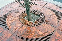 I would LOVE this kind of detail at NAYA or Generations. Beautiful Coast Salish artwork by Susan Point-(Musqueam) Native American Artists, Canadian Artists, Urban Furniture, Street Furniture, Urban Landscape, Landscape Design, Tree Grate, Landscaping Retaining Walls, Backyard Landscaping