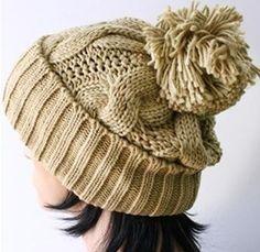 Prety hand knitted khaki beanie wool hat with pompom. via Etsy.