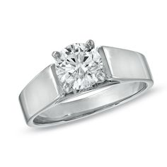 An exceptional stone...1-1/4 CT. Certified Diamond Solitaire Engagement Ring in 14K White Gold (J/I2)