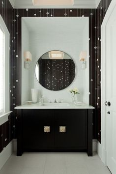 A modern bathroom with a whimsical black and white wall design. Photography by http://www.emilygilbertphotography.com/