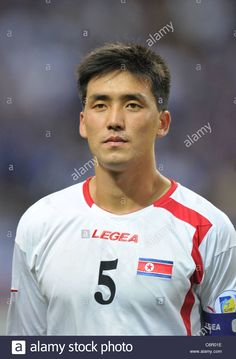 Download this stock image: Ri Kwang Chon (PRK) playing for FIFA World Cup Brazil 2014 Asian Qualifier Third Round Group C match : Japan 1-0 North Korea - c6r01e from Alamy's library of millions of high resolution stock photos, illustrations and vectors.