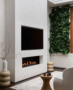 """Designed in collaboration with @dkinteriors, our linear fireplace in this """"Relaxation Room"""" provides a beautiful contrast to the cool white walls and neutral furnishings. Echoed in the feature wall, the dancing flame radiates warmth in the coolest of lounge spaces."""