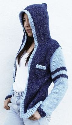 Free Knitting Pattern for Varsity Hoodie - This long-sleeved hooded sweater with pocket is knit primarily in stockinette. The designer Two of Wands and Lion Brand Yarn rate this a Level 2 Easy (beginner +) pattern. It does require picking up stitches and grafting. Sizes M/L, XL/2XL, XS/S