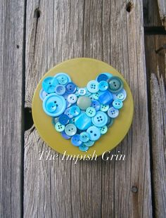 A personal favorite from my Etsy shop https://www.etsy.com/listing/492359616/repurposed-recycled-blue-button-heart