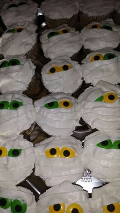Mummy cupcakes using @Wilton Cake Decorating Cake Decorating candy eyes. So easy and fun!