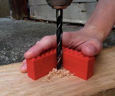 Using a LEGO jig to drill straight holes with a hand drill - smart idea! I love simple :-) #DIY