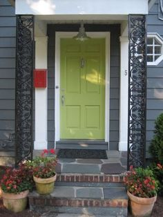 Love all of this, the contrast of door and mailbox, the shade of green, the columns, the stone.  Great!!