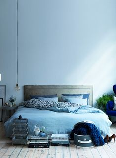 Bed on floor in blue hues