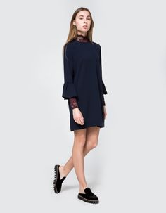 Shift dress from Ganni in Total Eclipse. Round neckline. Long sleeves with flounce detail at cuff. Straight hem. Straight silhouette. Unlined.  •	Crepe •	97% polyester, 3% elastane  •	Machine wash cold