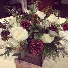 Christmas centerpiece | centerpiece with pinecones and cedar | burgundy white and green centerpiece | meridian ms wedding florist | wooden box centerpiece